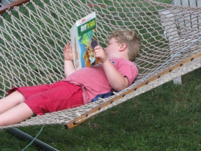 Harvey in the hammock reading an Asterix book