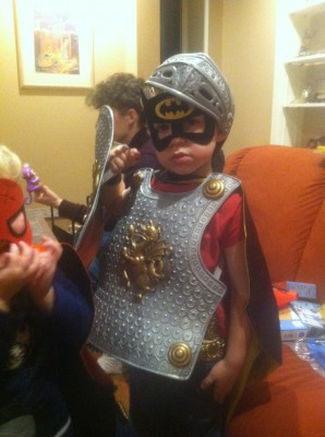 Zion wearing Hanukah presents: knight armor and batman mask