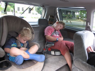 Zion and Harvey asleep in the car