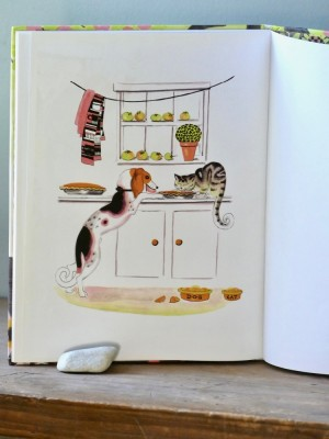 the last page of the book: cat and dog stealing pie off the counter