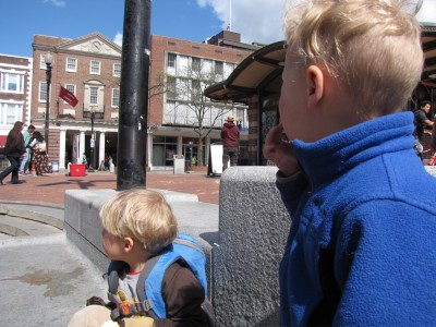 Zion and Lijah snacking in the middle of Harvard Square