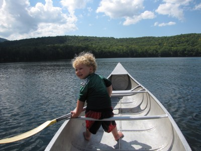 Harvey at the bow of the canoe on the lake