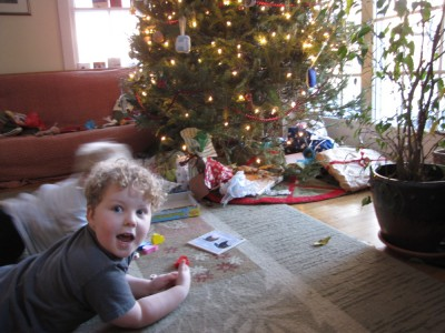 Harvey and Zion by our tree playing with their presents; Harvey looking excited