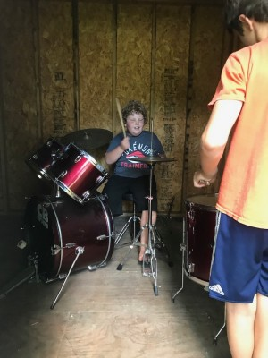 Harvey playing drums in the Jacksons' shed