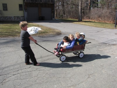 Harvey pulling four kids in the wagon