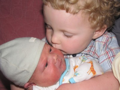 harvey kisses his baby brother