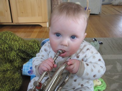 Harvey trying to play the cornet