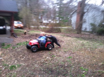 Harvey pushing Zion and a friend in a non-powered ride-on jeep