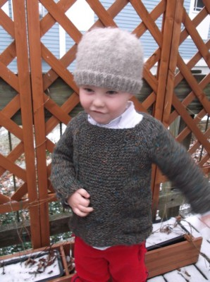 Harvey in his sweater on Grandma's porch--motion blur on his arms