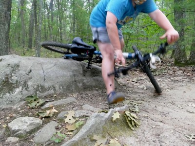 Harvey crashing his bike going over a big rock