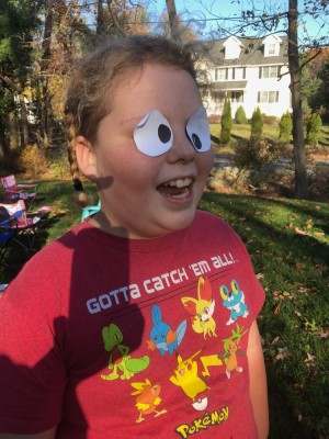 Harvey being silly with paper cartoon eyes taped to his eyes