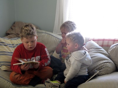Harvey reading to his brothers on the couch