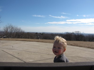 Lijah sitting on a bench at the top of Arlington Heights