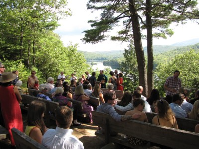 the view down to the lake over the heads of the wedding audience