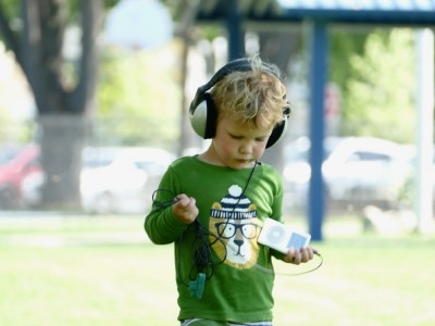 Lijah walking outside wearing big headphones
