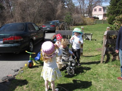 kids with easter baskets on their heads