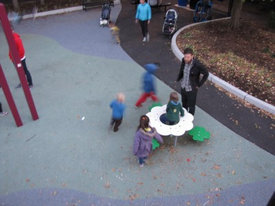 Harvey and Zion, seen from above, running on the playground