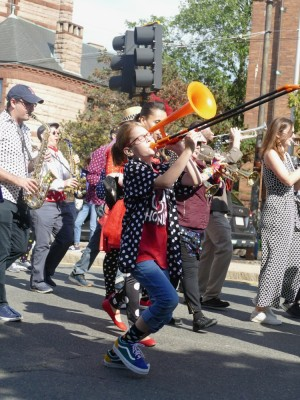 a young female trombone player rockin out in the parade