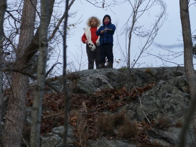 Harvey and Zion on a rocky hilltop by Horn Pond
