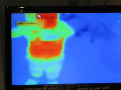 Harvey on the heat camera screen lifting his shirt to show his red belly