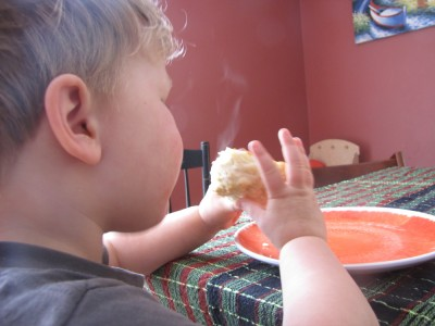 Lijah blowing on a steaming biscuit