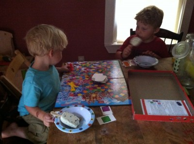 Harvey and Zion eating ice cream pops and playing Candyland