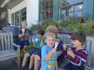 boys enjoying ice cream outside Bedford Farms
