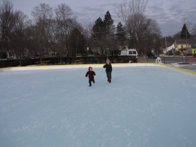Harvey and Zion running on the outdoor ice rink