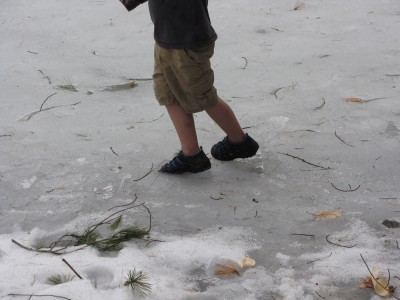 Zion on the slushy ice in shorts and sandals
