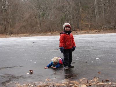 Harvey standing, Zion fallen down on the ice