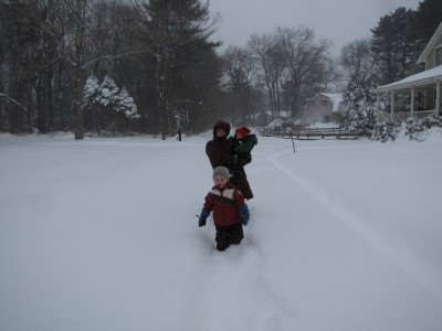 Harvey, Zion, and Mama walking down the snowy street