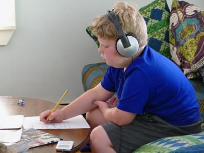 Harvey doing math work listening to music on the headphones