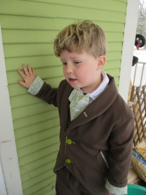 Harvey in his Easter suit leaning against the wall of the house