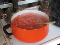 strawberry jam bubbling on the stove