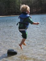 Zion airborn, leaping from a rock into very shallow water