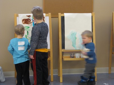 the boys painting at easels at Kids Church