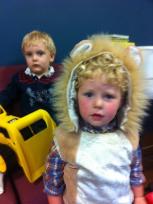 Harvey in a lion costume with Ollie behind him
