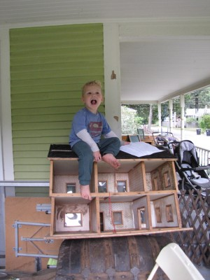 Lijah atop the doll house (itself up on a steamer trunk)