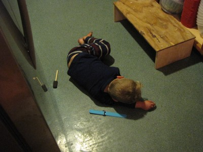 Lijah asleep on the kitchen floor