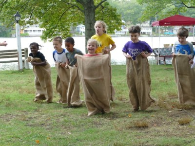 Zion in the midst of a sack race by a lake