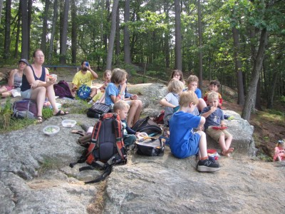 lots of kids picnicing on the rock above Fawn lake