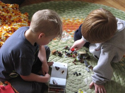 Zion and Nathan building legos on the schoolroom rug