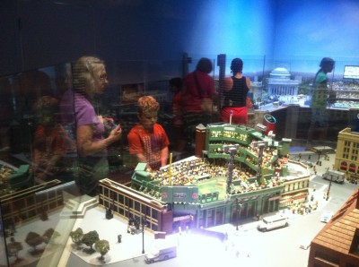 Grandma Judy and Harvey looking at Fenway Park rendered in Legos