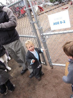 Lijah trying to squeeze through the gate into the egg hunt
