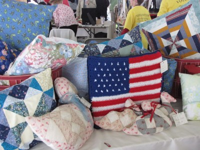 a variety of quilted crafts on display