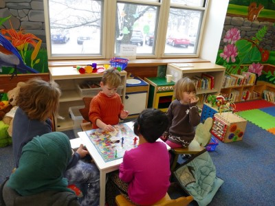 Lijah playing Candyland with friends at the Chelmsford library