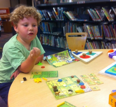 Harvey and Agricola in the kids room at the library