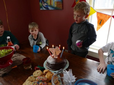 Lijah blowing out the candles on his chocolate pokeball cake