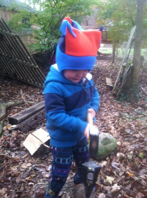 Lijah using the mallet and log wedge