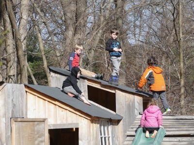 Lijah and four friends on the roof of the playhouse